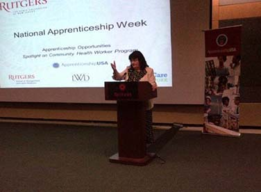 Patricia Moran, executive director of Workforce Development and Economic Opportunity for the state Labor Department, delivering remarks at the National Apprenticeship Week event held at Rutgers University's Busch Campus Center.